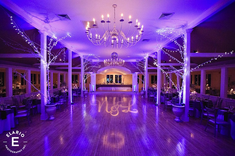 The Old Daley Inn on Crooked Lake with Purple Up Lighting & Monogram - Photo by Elario Photography